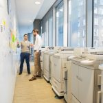Businessmen discussing over notes stuck on wall
